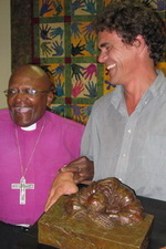 Niël presenting the Emeritus Archbishop Desmond Tutu with his 80th birthday present.